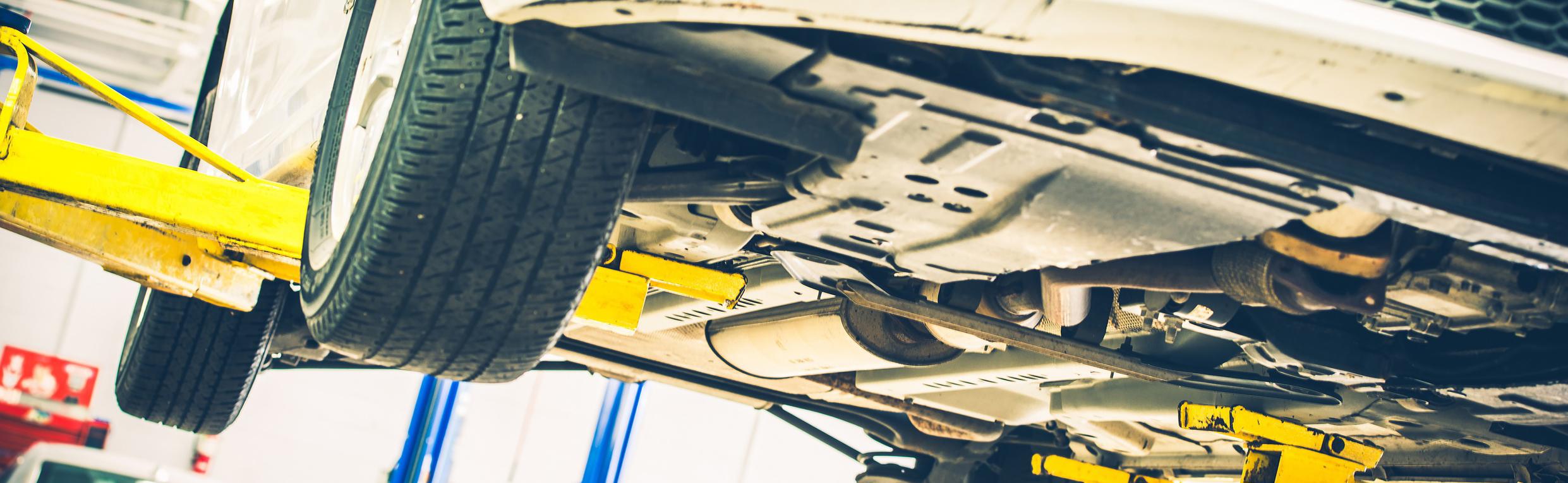 Close-up of car mechanic fixing automotive engine